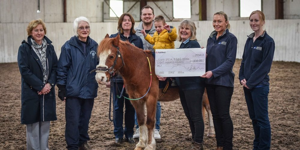 Staff from Hampton Veterinary Centre presenting a cheque