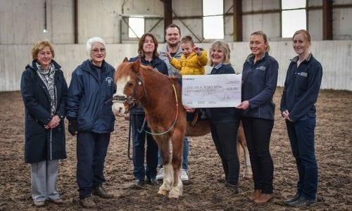 Staff from Hampton Veterinary Centre presenting a cheque